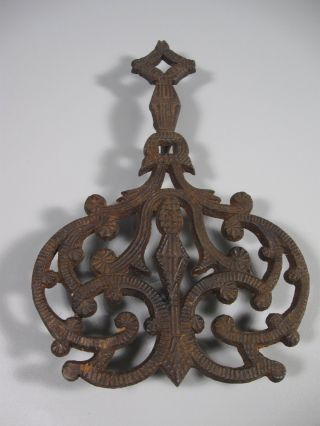Antique Iron Trivet photo