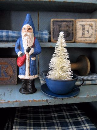Bottle Brush Christmas Tree In A Tiny Antique Blue Tin Toy Cup And Saucer photo
