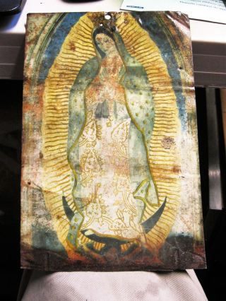 Antique Retablo On Tin Of Our Lady Of Guadalupe photo