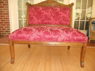 Vintage Armless Settee With Unique Ribbon And Bow Pattern photo
