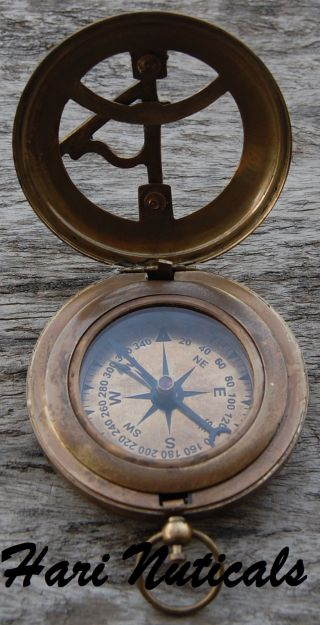 Antique Brass Compass Nautical Compass Push Button Old Time Sundial Compass photo