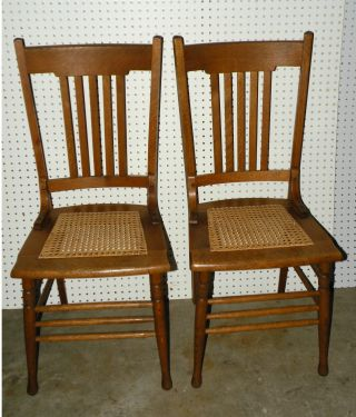Pair Vintage Oak Caned Seat Chairs photo