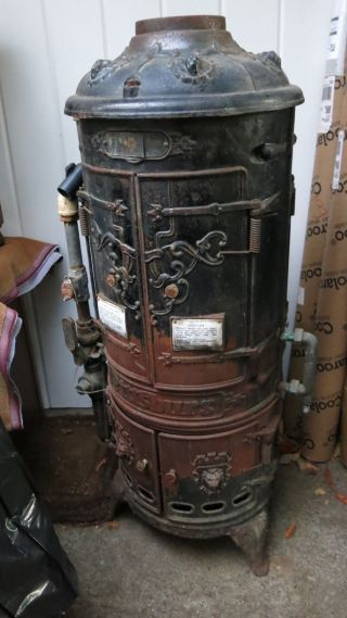 Antique Pittsburg Cast Iron Instantaneous Water Heater photo