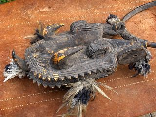 Carved Wood Spirit ' S Head,  Mindimbit Village,  Papua Guinea photo