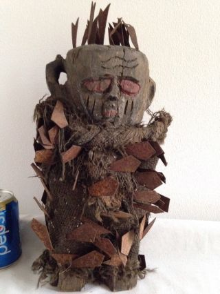 Very Old Bizarre Looking Carved African Figure With Metal Spikes photo