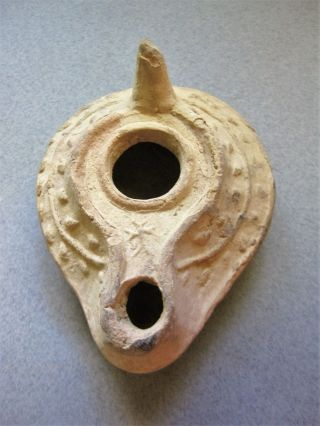 A Byzantine Pottery Oil Lamp With Cross,  6th To Early 7th Century Ad photo