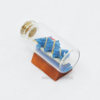 6.  4cm Mini Ship In A Glass Bottle Blue Sail Oceangoing Marine Handcrafted Boat photo
