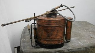 Vintage Copper Brass Tank Backpack Sprayer For Grapes In The Vineyard photo