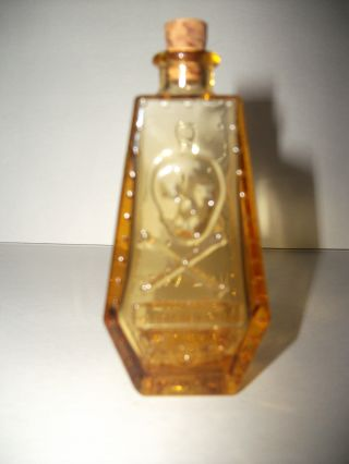 Old Poison Bottle Shaped Like A Coffin W/ Skull And Cross Bones photo