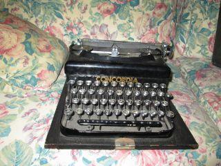 Two (2) Pre - War,  Wartime,  Portable Typewriters,  Royal,  L.  C.  Smith & Corona. photo