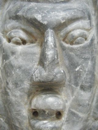Old Stone Face Mask Carving With Inlay Stone photo