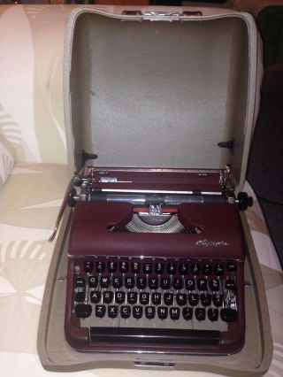 Antique/vintage 1950s Olympia De Luxe Typewriter Burgundy Case Flawless photo