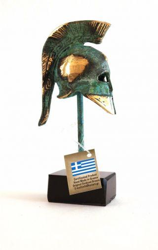 Ancient Greek Bronze Miniature Helmet On Stand Green Gold Oxidization 387 - 1 photo