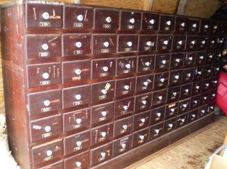 Antique Hardware General Store Display Cabinet 77 Drawer Wood Porcelain Mi photo