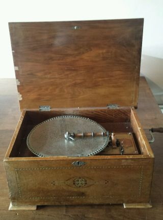 An Antique Walnut Cased Disc Playing Music Box And Discs Circa 1890. photo