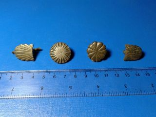 Ancient Bronze Pad On Belt. photo