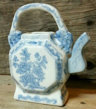 Antique Porcelain Chinese Teapot.  Blue Rose Pattern. photo