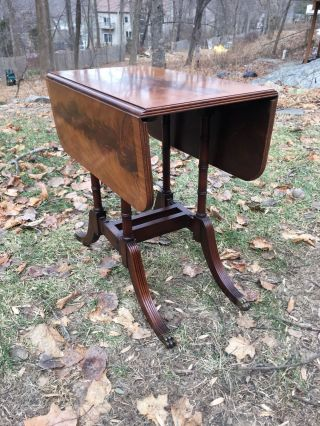 Outstanding Flame Mahogany Banded Small Size Drop Leaf Table 1930s photo