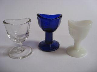 3 Vintage Antique Glass Vintage Medical Eye Cups Cobalt Blue Milk Glass & Clear photo