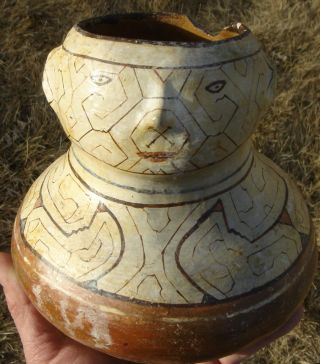 Face Pot: Sacred Fertility Lines.  Eastern Peru photo