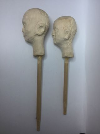 Vintage Pair Hand Carved Wooden Heads On Sticks photo