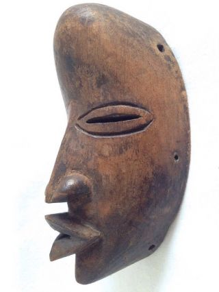 Most Interesting Old Very Small Carved African Face Mask - photo