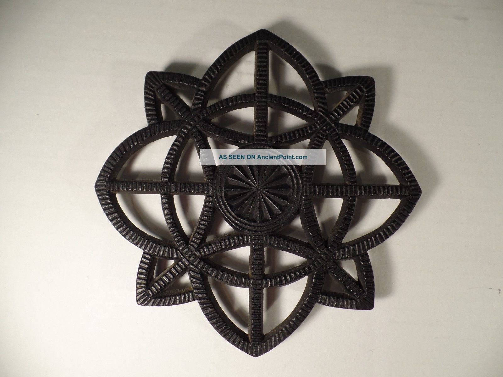 Vintage 1944 Jzh Cast Iron Trivet Pinwheel Trivets photo