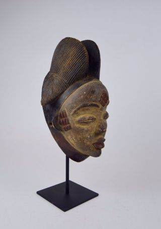 A Very Fine Punu African Mask On Display Stand photo