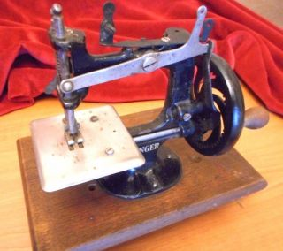Antique Miniature Sewing Machine Singer photo
