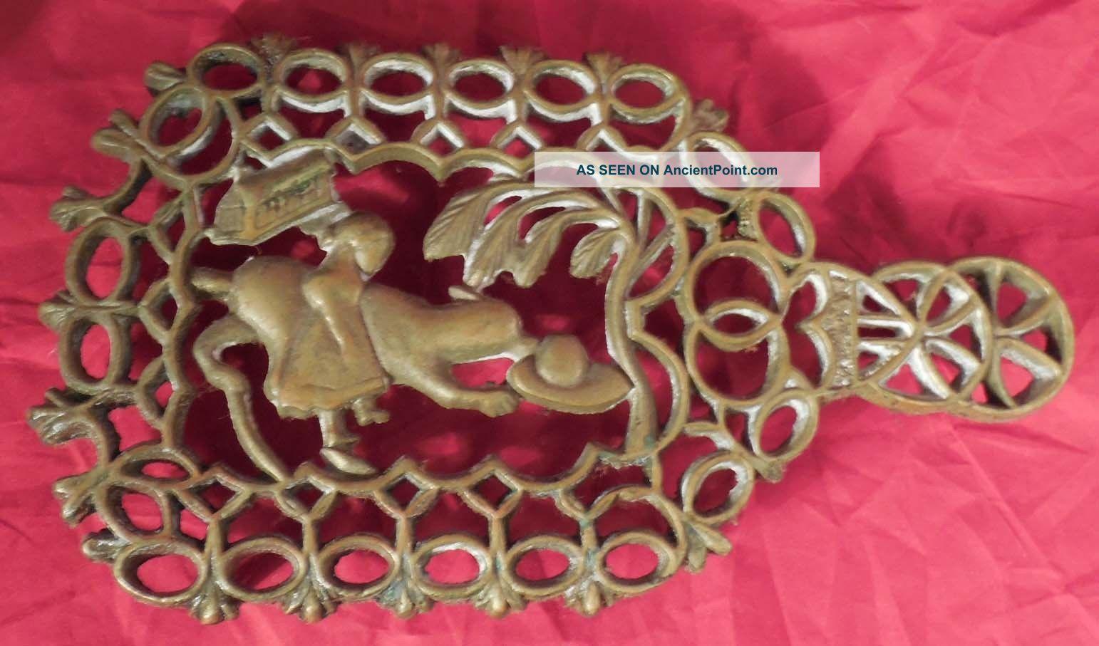 Antique Brass Sad Iron Trivet Girl Dog Trivets photo