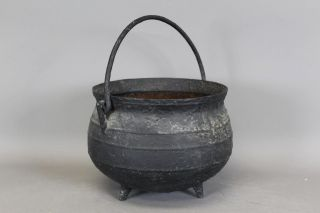 Rare Large Size 17th C Cast Iron Hanging Tall Footed Pot In Old Painted Surface photo