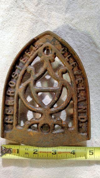 Antique Ferrosteel Clevland Sad Cast Iron Trivot Iron Rest photo
