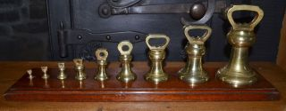 English Vintage 9 Brass Bell Weights On Mahogany Stand 18 3/4 ' X 4 3/4