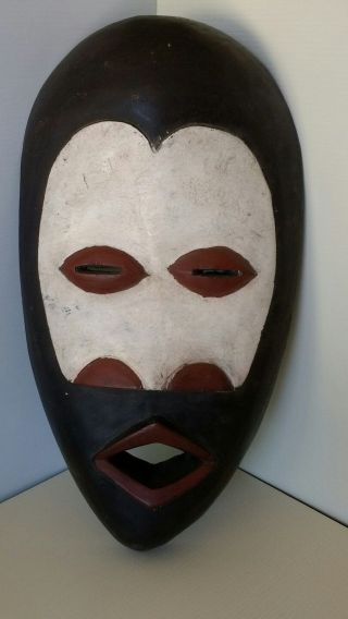 African Dan Mask From Liberia Represents Feminine Beauty photo