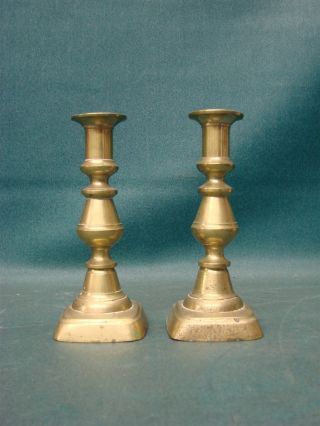 Antique Brass Push - Up Candlestick Holders photo
