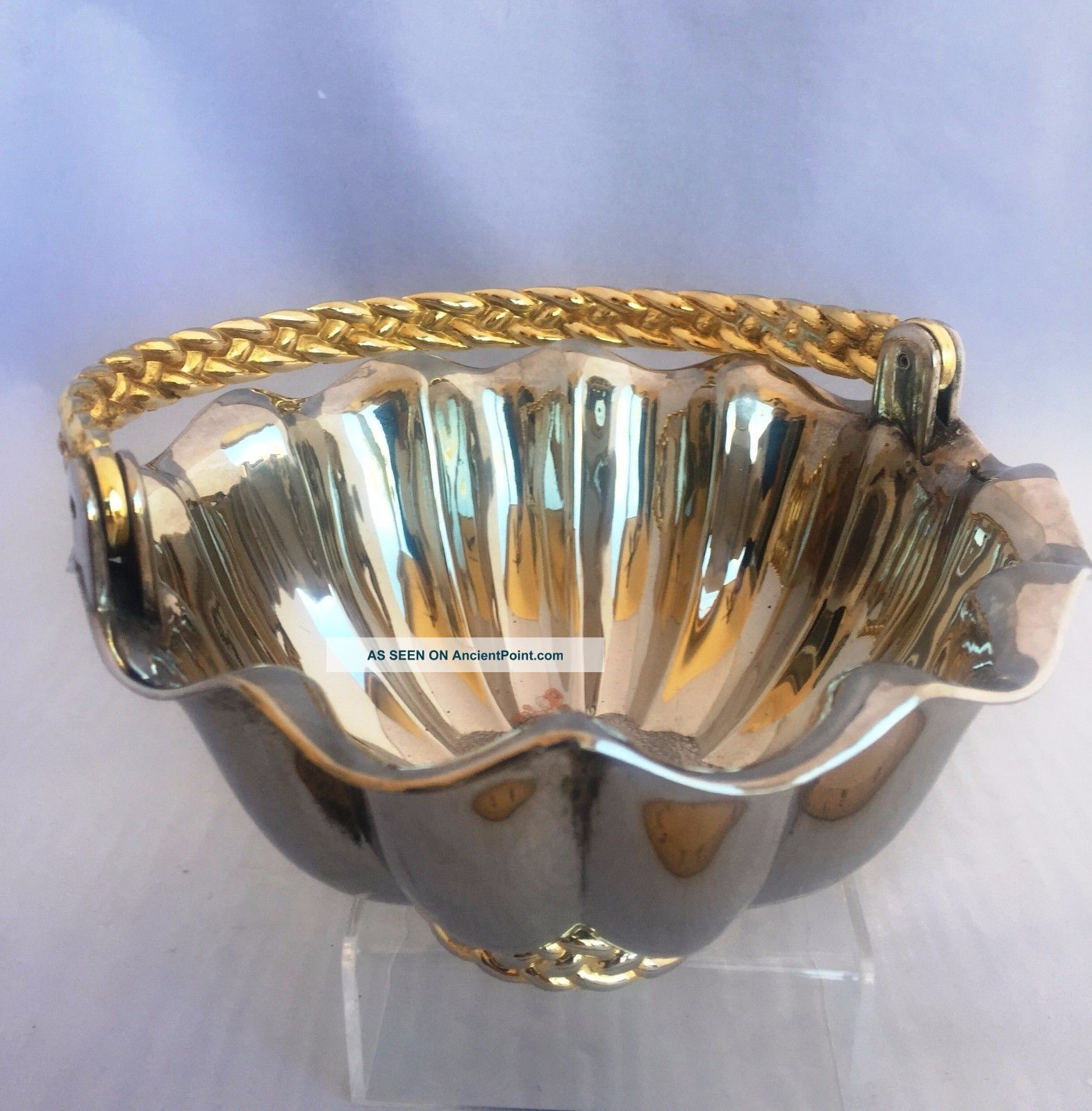 Silver Plate Scalloped Basket With Gold Tone Braided Handle. Baskets photo
