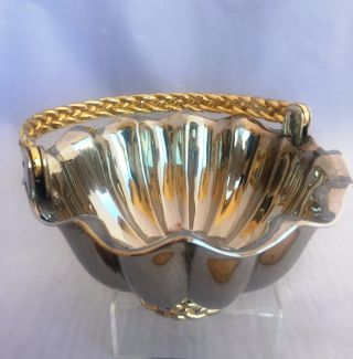 Silver Plate Scalloped Basket With Gold Tone Braided Handle. photo