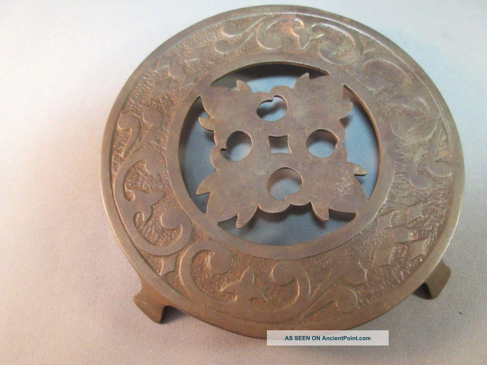 Antique Metal Decorative Round Cut - Out Trivet Sun Dry Manufacturing Company Trivets photo