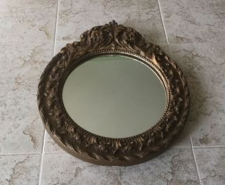Ornate Embossed Decorative Round Wood Mirror - Antique.   556 photo