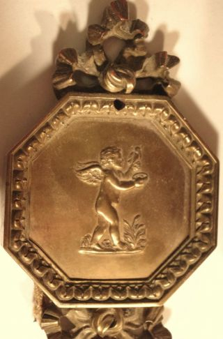 Pair E.  F.  Caldwell Bronze Sconces With Winged Putti Holding Birds Nest. photo
