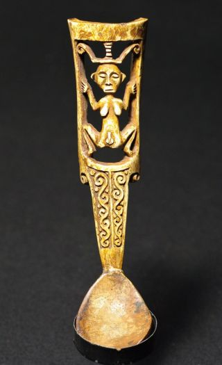 Bone Spoon With Hermaphroditic Figure photo