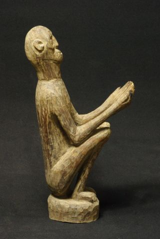 Expressive Figure Of Ancestor With Outstreched Hands - Timor - Indonesia photo