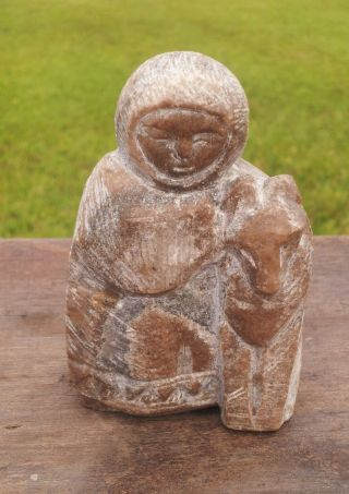 Vintage Inuit Soapstone Carving Of An Eskimo With His Sled Dog photo