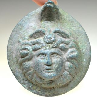 Roman Bronze Roundel Depicting Head Of Gorgon Medusa photo