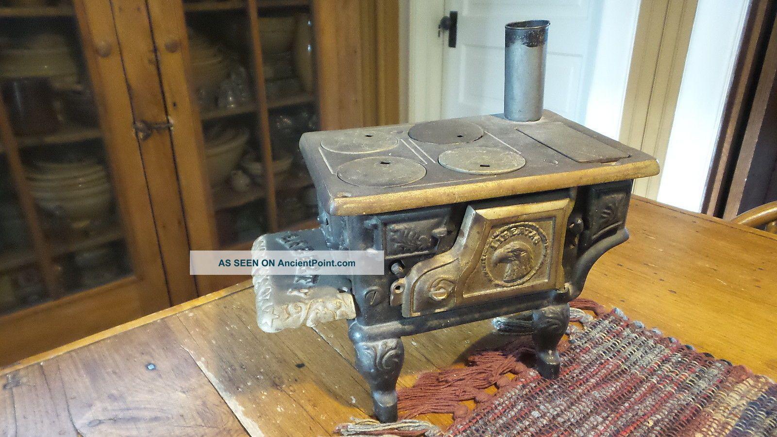 Antique Toy Cast Iron Stove,  Liberty & Utensils Miniature Stoves photo
