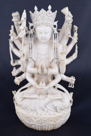 Chinese Carving Of A Multi - Armed Maitreya photo