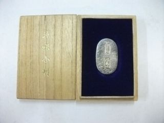 The Koban Of Japan Of Virgin Silver.  Tokyokaito,  Made Of.  5g/ 0.  18oz. photo
