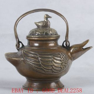 An Old Copper Hand Carved Duck Teapot With Qing Dynasty Mark photo