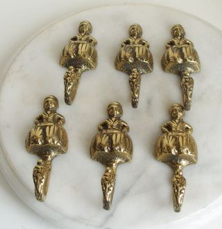 6 Vintage Brass Dutch Boy Hooks photo