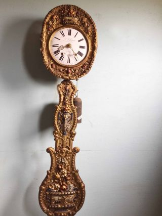 Antique And Wonderfully Decorated Comtoise Clock - photo